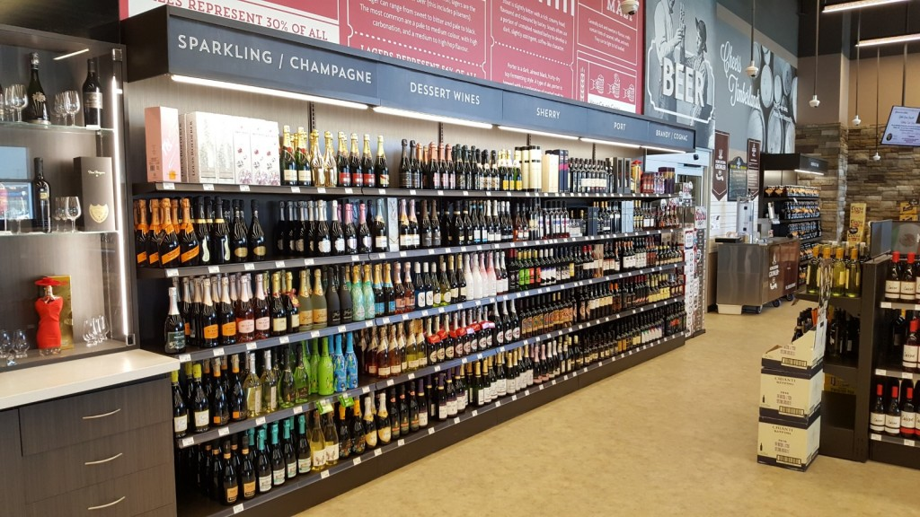 7. Large Format Liquor Store Wall Display with Lit Valence and Wood Ticket Channel