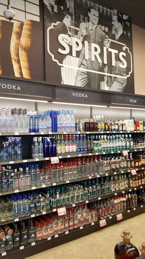 8. Large Format Liquor Store Wall Display with Lit Valence and Wood Ticket Channel
